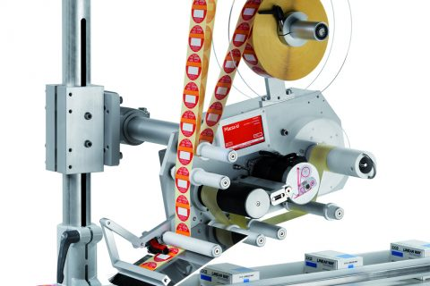Label applicator solution by rotary arm for 2 double sided labels